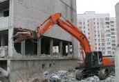 Демонтаж зданий с применением строительной техники